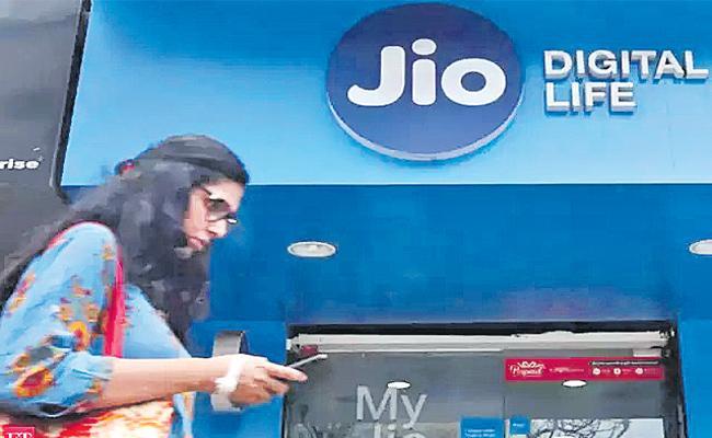 Jio Profits in June Fiscal year - Sakshi