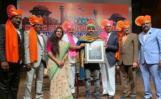 Telangana Short Film Maker Dr Anand Awarded For His Social Service - Sakshi