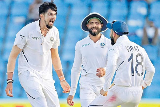 India bowl out West Indies for 222 in 1st innings - Sakshi