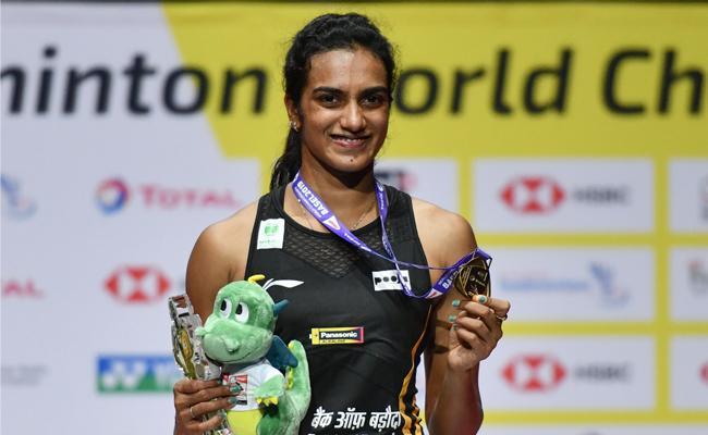 Modi Congratulates PV Sindhu For Winning BWF World Championships - Sakshi