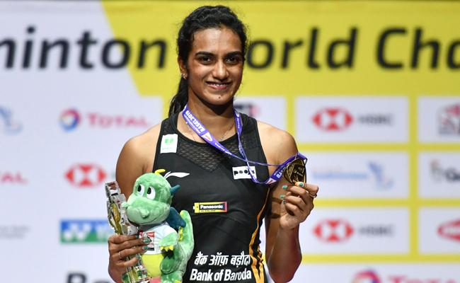 PV Sindhu becomes first Indian to win World Badminton Championships gold - Sakshi
