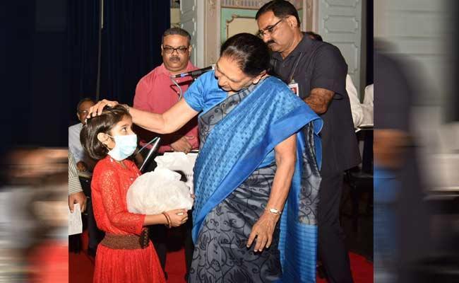 Uttar Pradesh Governor Anandiben Patel Adopt A Child Suffering From TB - Sakshi