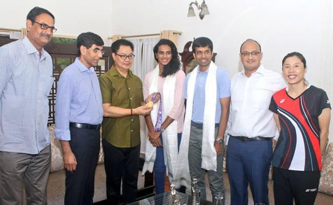 PV Sindhu Reached India After Winning Gold At BWF Switzerland - Sakshi