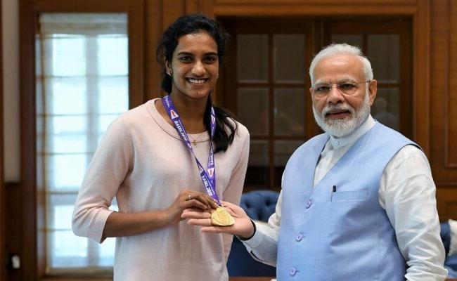 PV Sindhu Meets Narendra Modi - Sakshi