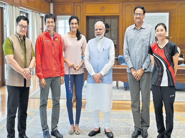 Narendra Modi Says PV Sindhu is the proud champion of the country - Sakshi