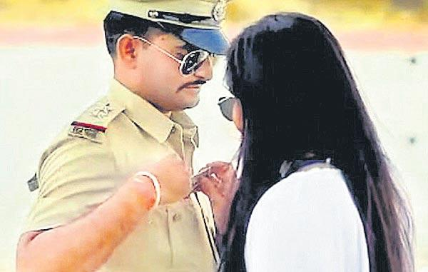 Accepting bribe from fiancee in pre-wedding video lands Rajasthn - Sakshi