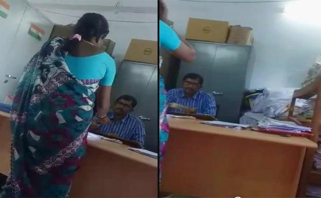 Labour Officer Caught On Video Accepting Bribe In Suryapet District - Sakshi