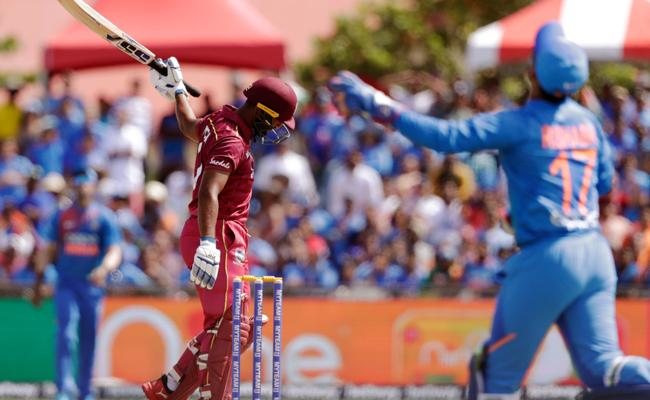 West Indies Lost 5 Wickets In 6 Overs Against India T20 - Sakshi