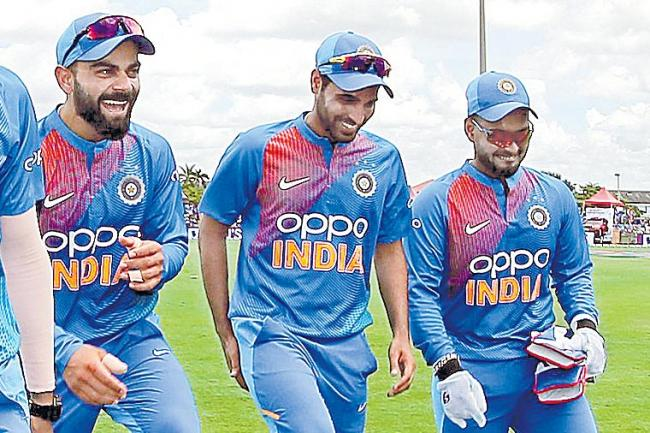 India beat West Indies by 4 wickets - Sakshi