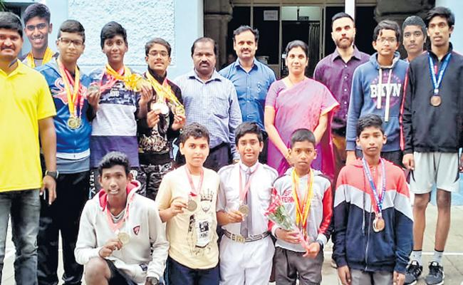 Rajat Abhiram Wins Swimming Title - Sakshi