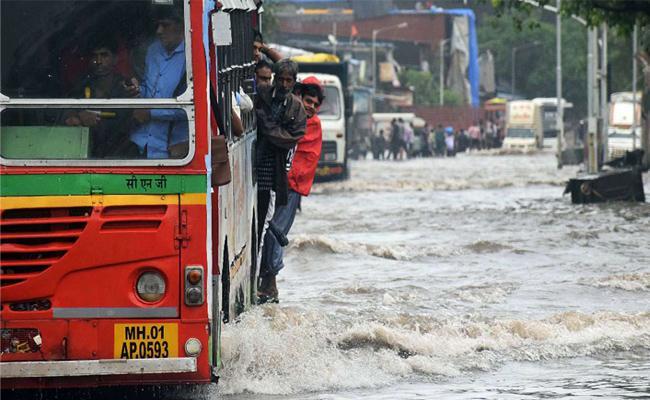 Mumbai rains, All local trains operational, schools, colleges shut - Sakshi