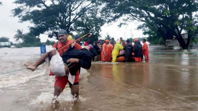 Red Alert For Heavy Rainfall Issued By IMD - Sakshi