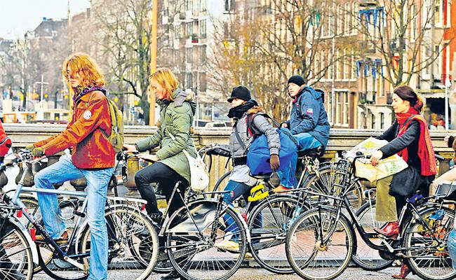 Netherlands Government pay Money For Cycling - Sakshi