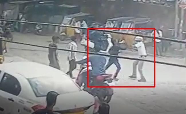 Young Men Attack Traffic Home Guard On Road In Hyderabad - Sakshi
