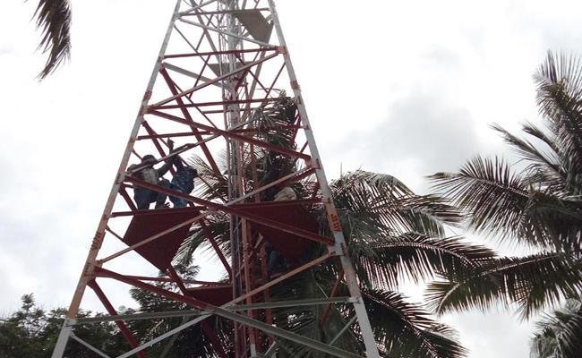5 Dalit Youngs Protest By Climbing Signal Tower In East Godavari Over Remove Ambedkar Statue   - Sakshi