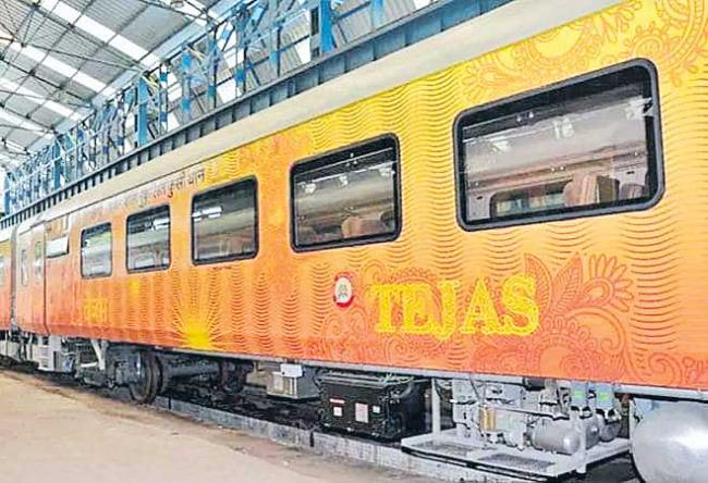 Free travel insurance of Rs 25 lakh each for passengers on board Express - Sakshi