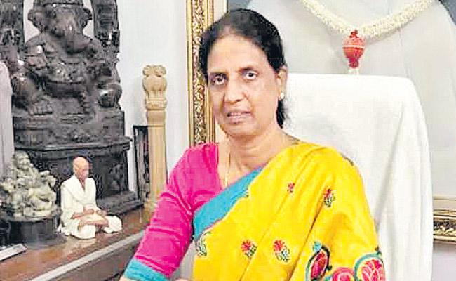 Sabitha Indra Reddy Giving Advice to NRI - Sakshi