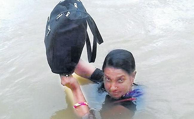 Odisha Teacher Crosses A River Everyday To Reach School - Sakshi
