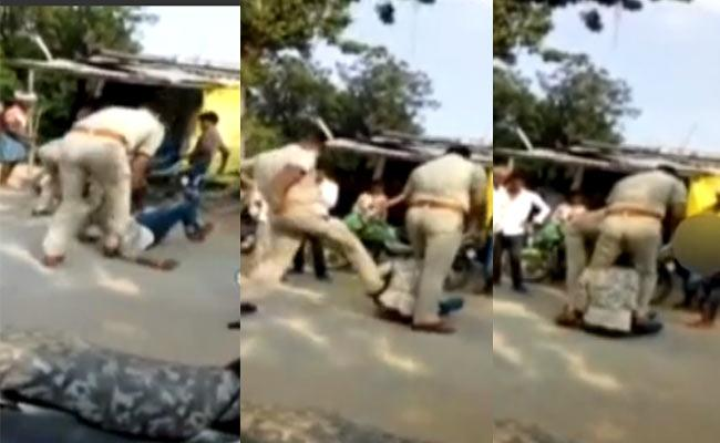 Two Policemen Suspended For Thrashing Young Man UP - Sakshi
