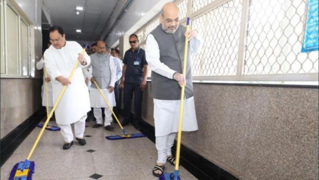 Amit Shah Sweeps Floor at AIIMS For PM Modi Birthday Week - Sakshi
