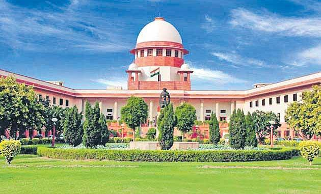 Govt review plea in top court against SC/ST Act - Sakshi