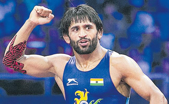 World number one Bajrang Poonia aims to win gold in wrestling - Sakshi