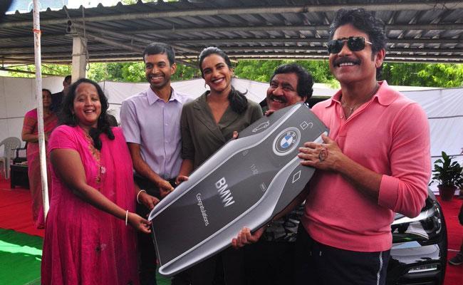 Nagarjuna Presented BMW Car To PV Sindhu - Sakshi