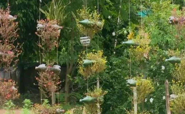 Bengal Forest Officer Creates Garden Using Plastic Bottles Rubber Tyres In Midnapore - Sakshi