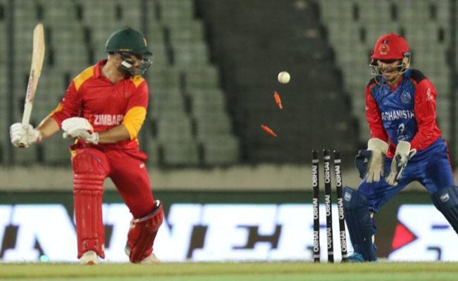 Afghanistan beat Zimbabwe by 28 runs - Sakshi
