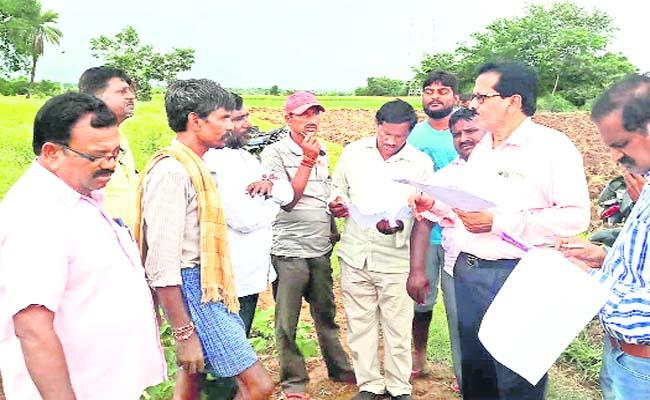 Officials Are Trying to Buy Land for Distribution to SCs in Warangal District - Sakshi