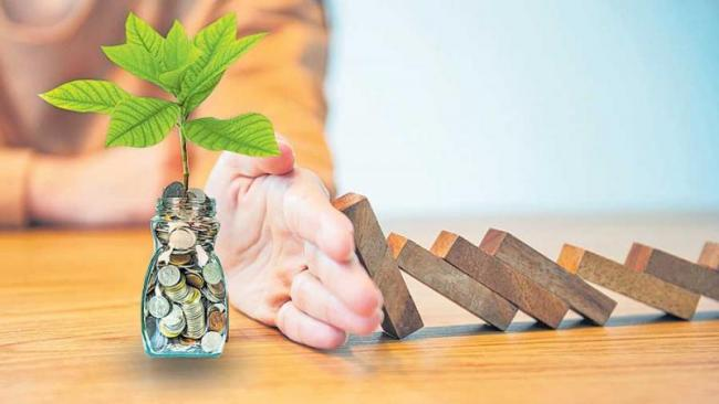 Ways to protect your money in case there's a recession - Sakshi