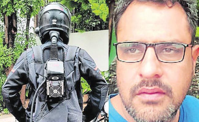 Karnataka Techie Develops AC Helmet for Summer comfort - Sakshi