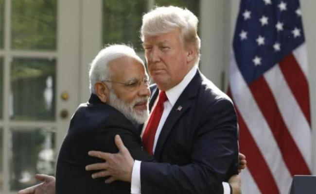 PM Modi Said That Trump's Gesture Is Delighted At Howdy Modi Mega Rally - Sakshi