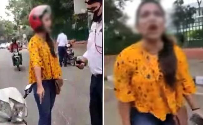 Young Woman Fight With Traffic Police On Delhi Road Over Challan - Sakshi