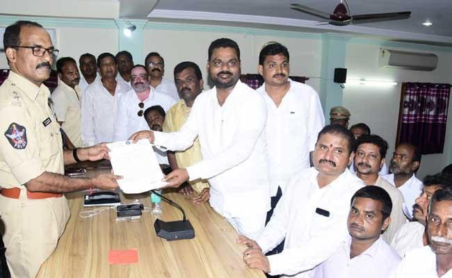 Complaint Against The TDP Leader Atchannaidu In Spandana - Sakshi