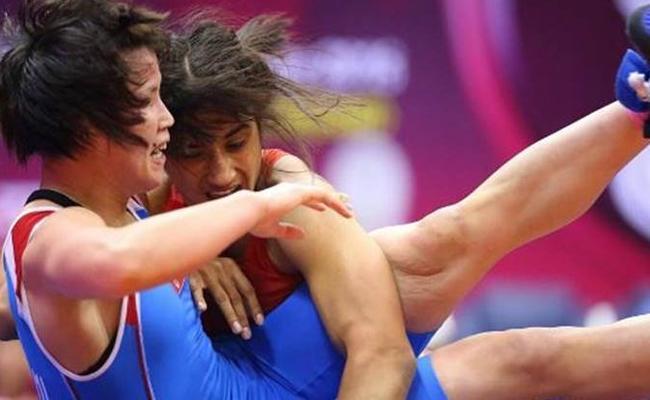 Vinesh Phogats World Wrestling Title Hopes End - Sakshi