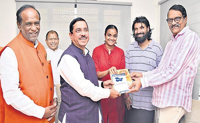 Union Minister Prahlad Joshi Meets Ashwini Dutt - Sakshi