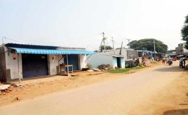 Shops Built On Pond Land At Vizianagaram - Sakshi