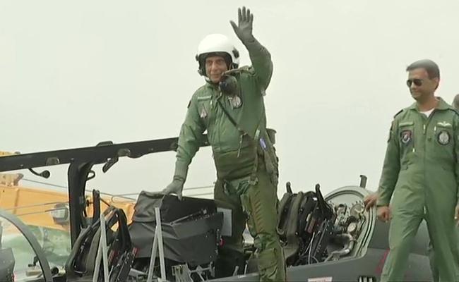 Rajnath Singh Flies In Fighter Jet Tejas - Sakshi