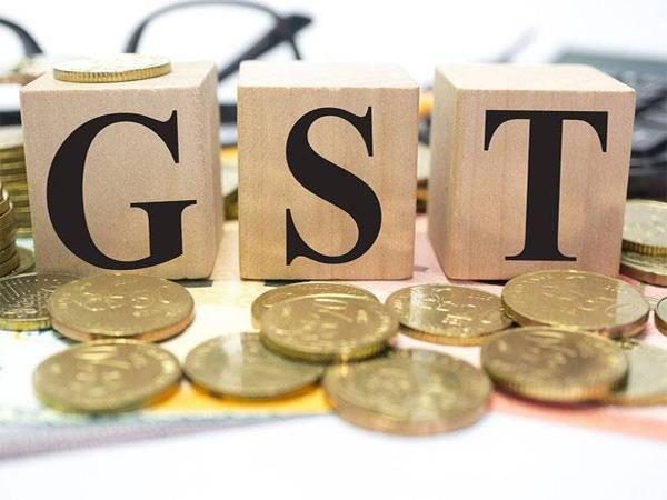 GST Fitment Committee Rejected Demand for Tax Rate Reduction on Biscuits and Cars - Sakshi