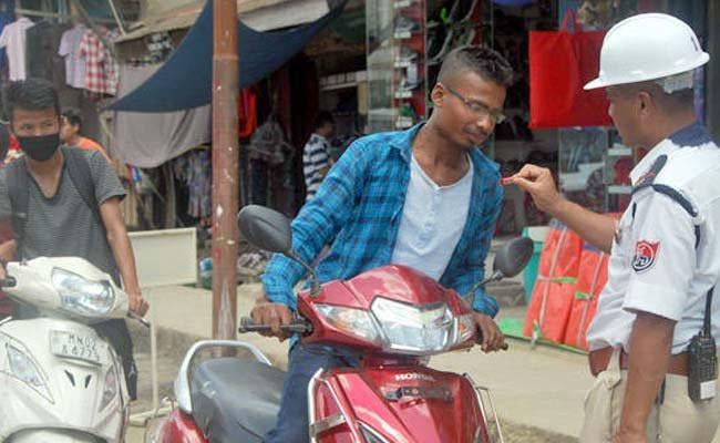 Manipur cops give sweets to people riding without helmet - Sakshi