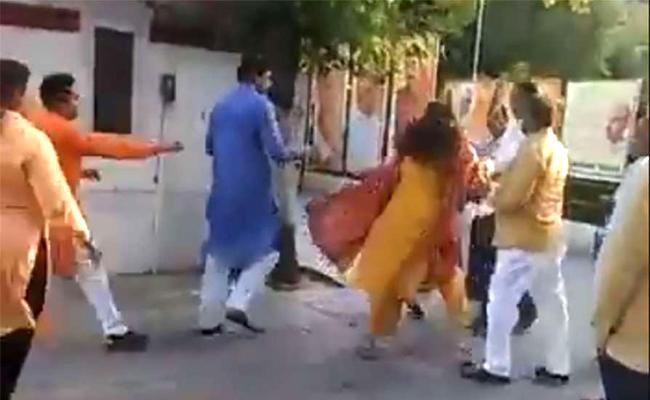 Delhi BJP Leader Seen Slapping Ex Mayor - Sakshi