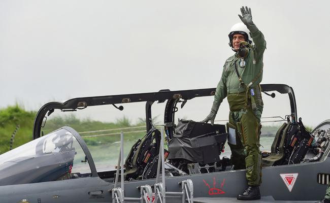 Rajnath Singh first defence minister to fly in indigenous Tejas - Sakshi