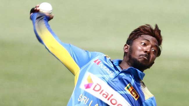 Akila Dananjaya banned from bowling for one year - Sakshi