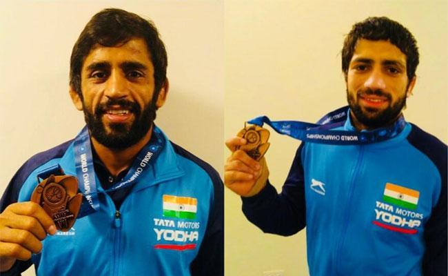 Bajrang Punia And Ravi Dahiya Win World Wrestling Championships - Sakshi