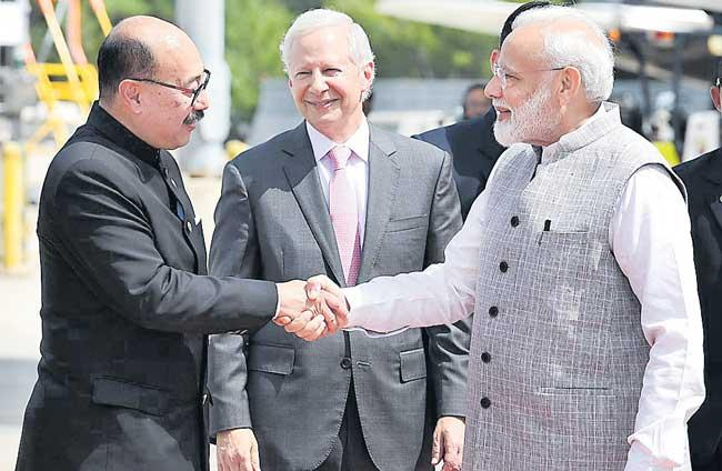 PM Narendra Modi arrives in Houston for mega diaspora event - Sakshi