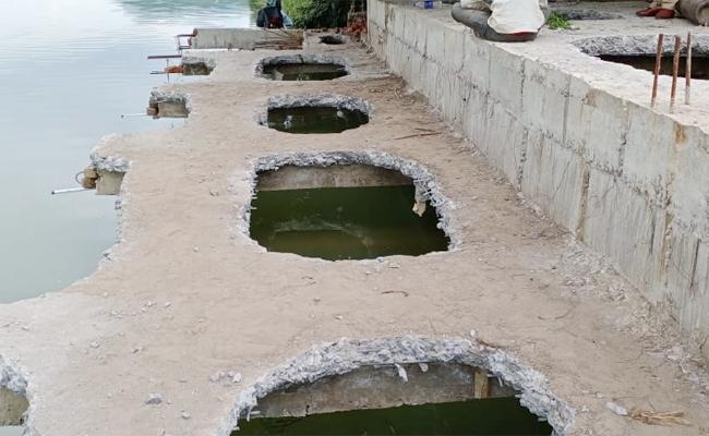 Action On Unauthorised Construction Along Krishna River - Sakshi