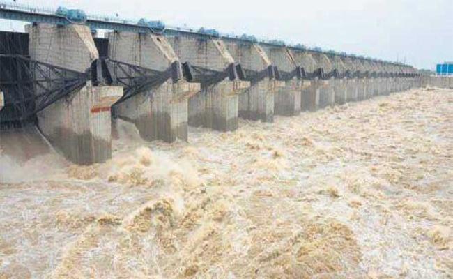 Flood to Prakasam Barrage; Collecter Alerted Authorities - Sakshi