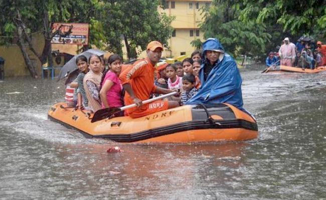 Heavy Rains in Bihar, Uttar Pradesh - Sakshi
