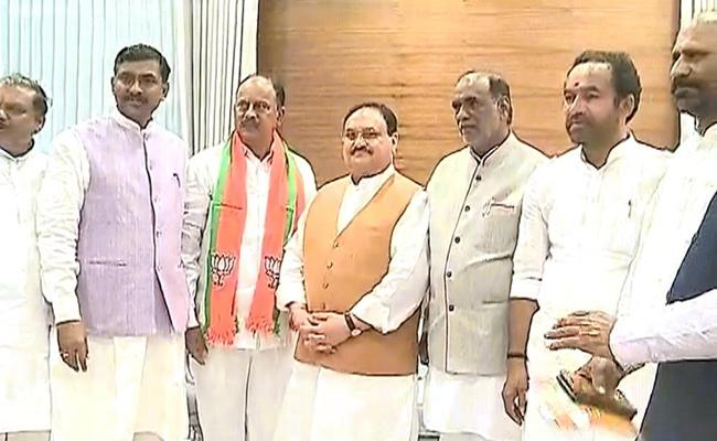 Revuri Prakash Reddy Ravindra Naik Jions BJP In Delhi - Sakshi
